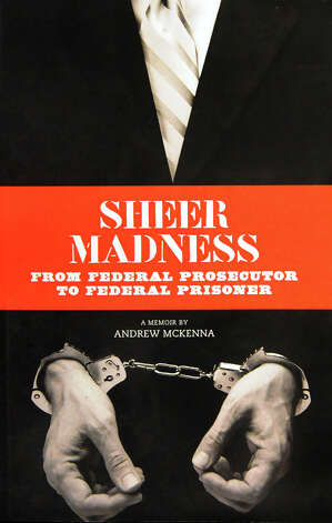 """Andrew McKenna's memoir, """"Sheer Madness: From Federal Prosecutor to Federal Prisoner,"""" on Tuesday, Jan. 13, 2015, at the Federal Public Defender Office in Albany, N.Y. (Cindy Schultz / Times Union) Photo: Cindy Schultz / 00030140A"""