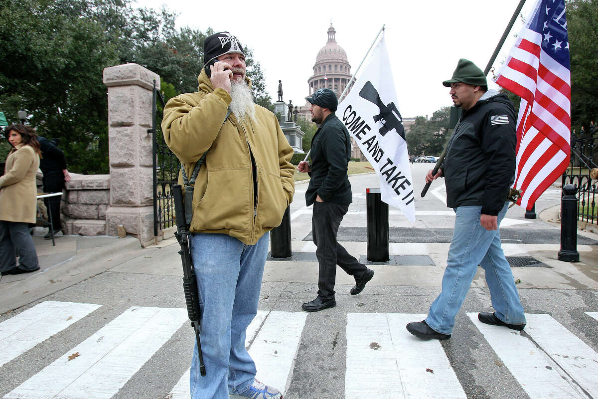 Phil Neumann,of Dallas, takes a call while demonstrating with others Tuesday for HB 195 before the session at the State Capitol.