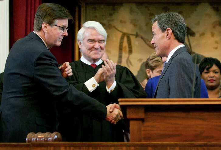 Speaker of the House Joe Straus, right, is congratulated by Lt. Gov.-elect Dan Patrick, left, and Texas Supreme Court Chief Justice Nathan Hecht, middle, before being sworn in as Speaker on the first day of the 84th legislative session at the Capitol in Austin, Tx., on Tuesday January 13, 2015.  (AP PHOTO/Jay Janner Austin American-Statesman)