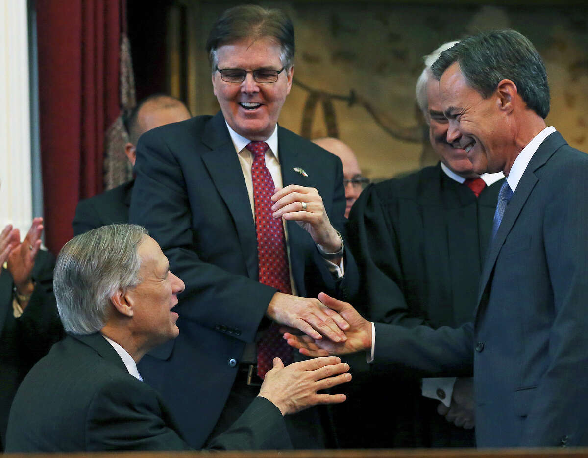 Joe Straus, right, accepts congratulations from Gov.-elect Greg Abbott and Lt. Gov.-elect Dan Patrick after being sworn in as speaker of the House during the opening of the Legislature.
