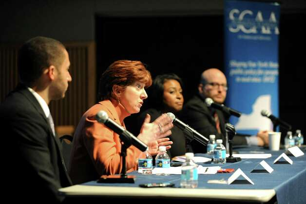 """Albany Mayor Kathy Sheehan, second from left, speaks during policy forum entitled """"New York's Cities: Confronting Income Inequality"""" on Tuesday, Jan. 13, 2015, at the New York State Museum in Albany, N.Y. Joining her, from left, are Ithaca Mayor Svante Myrick, Rochester Mayor Lovely Warren and Mike Konczal, a fellow with the Roosevelt Institute. (Cindy Schultz / Times Union) Photo: Cindy Schultz / 00030181A"""