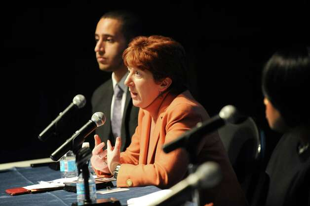 """Albany Mayor Kathy Sheehan, center, speaks during policy forum entitled """"New York's Cities: Confronting Income Inequality"""" on Tuesday, Jan. 13, 2015, at the New York State Museum in Albany, N.Y. Joining her are Ithaca Mayor Svante Myrick, left, and Rochester Mayor Lovely Warren. (Cindy Schultz / Times Union) Photo: Cindy Schultz / 00030181A"""