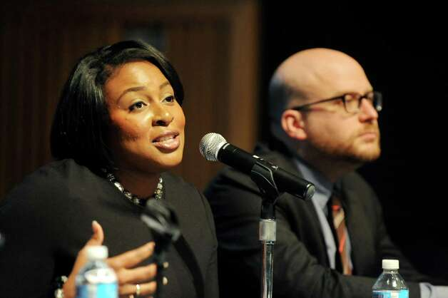 """Rochester Mayor Lovely Warren, left, speaks during policy forum entitled """"New York's Cities: Confronting Income Inequality"""" on Tuesday, Jan. 13, 2015, at the New York State Museum in Albany, N.Y. Joining her is Mike Konczal, a fellow with the Roosevelt Institute. (Cindy Schultz / Times Union) Photo: Cindy Schultz / 00030181A"""