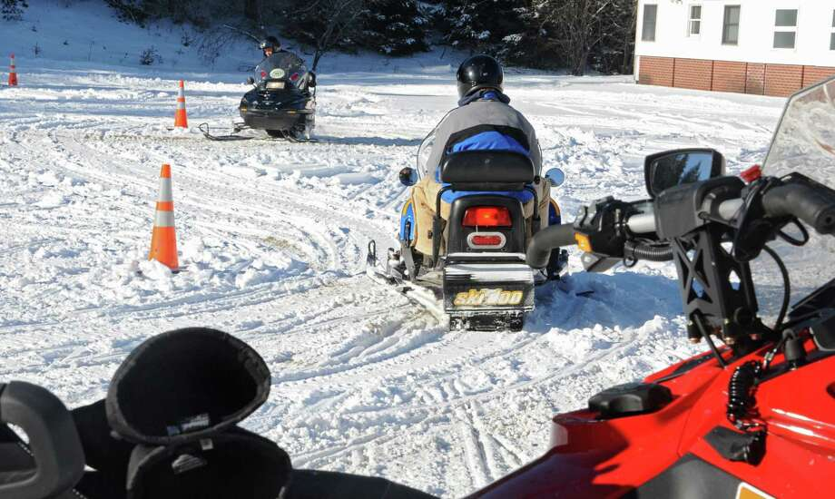 The state Office of Parks, Recreation and Historic Preservation is ended plans to to use a gun range at its Rensselaerville training area. In this photo, State Police learn snowmobile operation and safety training at the NYS Park Police Training Academy on Tuesday, Jan. 13, 2015 in Rensselaerville, N.Y. The training is to keep snowmobile trails in New York State safe.  (Lori Van Buren / Times Union) Photo: Lori Van Buren / 00030175A