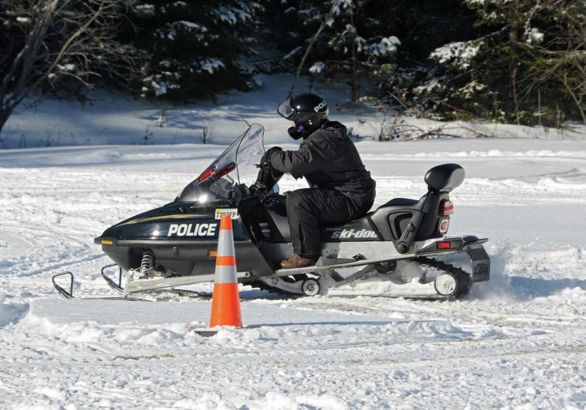 State Police learn snowmobile operation and safety training at the NYS Park Police Training Academy on Tuesday, Jan. 13, 2015 in Rensselaerville, N.Y. The training is to keep snowmobile trails in New York State safe. (Lori Van Buren / Times Union)