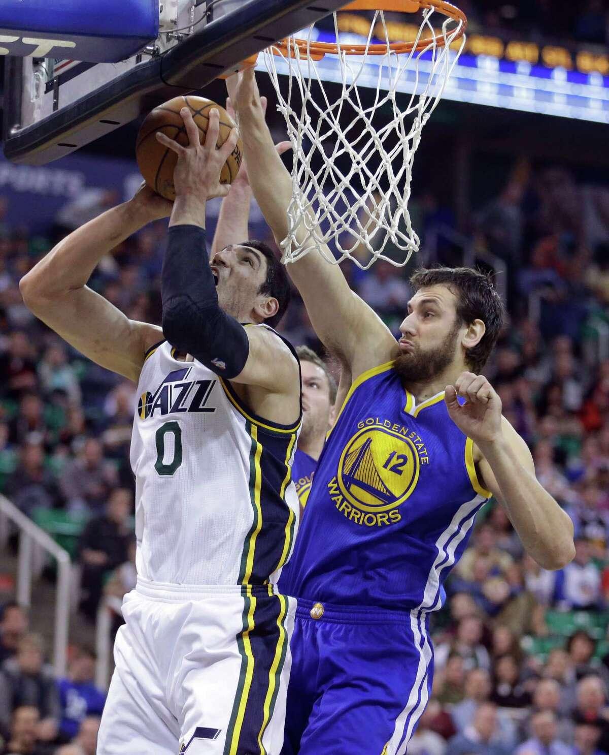Golden State Warriors center Andrew Bogut (12) defends against Utah Jazz center Enes Kanter (0) in the second quarter during an NBA basketball game Tuesday, Jan. 13, 2015, in Salt Lake City. (AP Photo/Rick Bowmer)