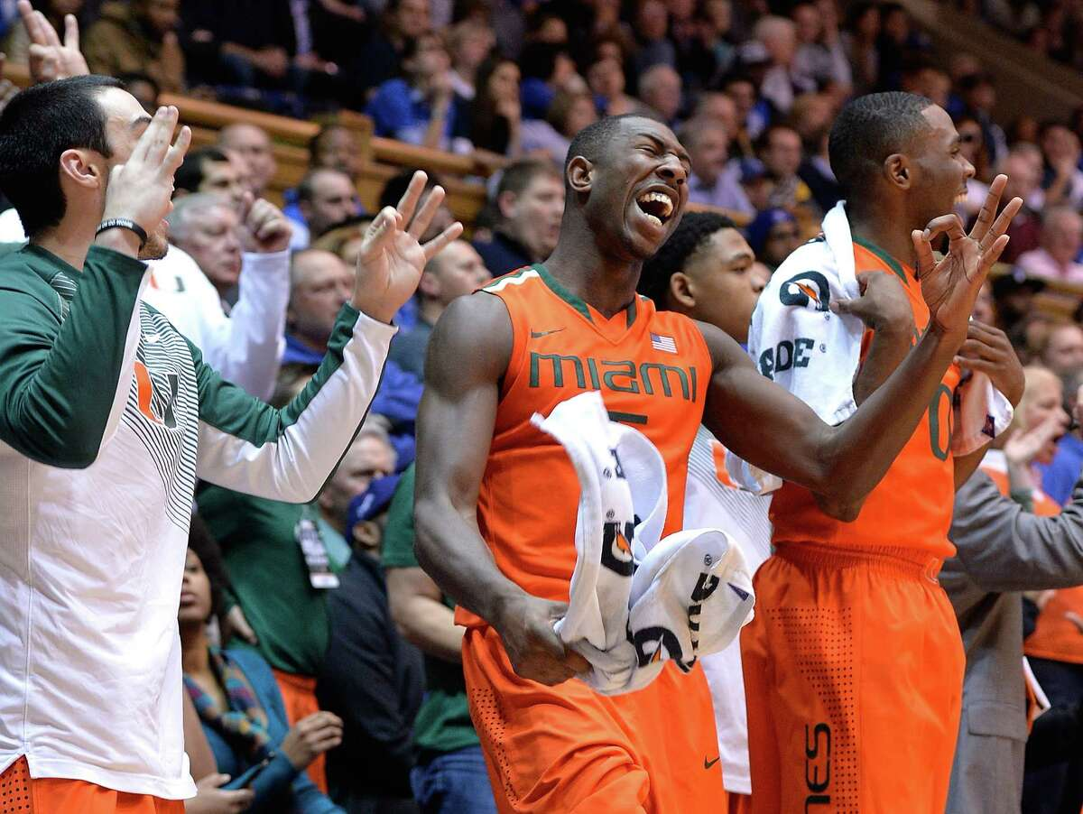 Players on the Miami bench enjoy their teammates' three-point shooting in a victory at fourth-ranked Duke.