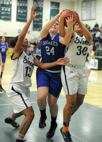 Shaker's Becky Rossieer, center, Shen's Sydney Brown, left, and Samira Sangare battle for a rebound during their girl's high school basketball game on Tuesday Jan. 13, 2015 in Clifton Park, N.Y. (Michael P. Farrell/Times Union) Photo: Michael P. Farrell / 00030162A