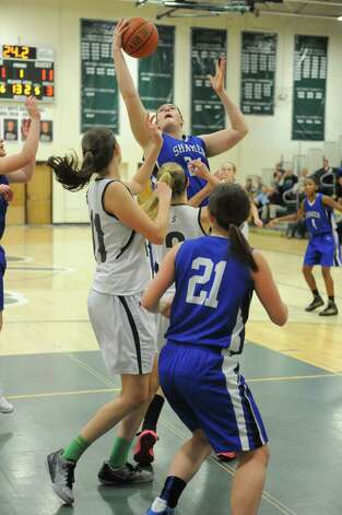 Shaker's Becky Rossieer pulls down a rebound during their girl's high school basketball against Shenendehowa game on Tuesday Jan. 13, 2015 in Clifton Park, N.Y. (Michael P. Farrell/Times Union) Photo: Michael P. Farrell / 00030162A