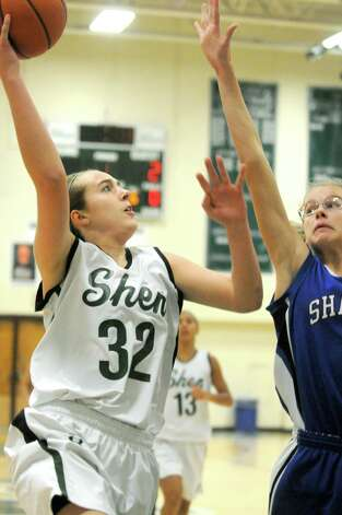 Shen's Carly Boland drives to the basket during their girl's high school basketball game against Shaker on Tuesday Jan. 13, 2015 in Clifton Park, N.Y. (Michael P. Farrell/Times Union) Photo: Michael P. Farrell / 00030162A