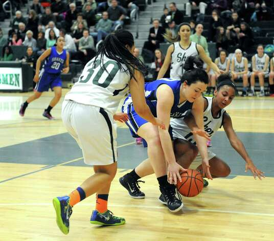 Shaker's Becky Rossieer, center, Shen's Samira Sangare, left, and Sydney Brown battle for a loose ball during their girl's high school basketball game on Tuesday Jan. 13, 2015 in Clifton Park, N.Y. (Michael P. Farrell/Times Union) Photo: Michael P. Farrell / 00030162A