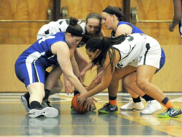 Shaker and Shenendehowa player try to get a handle on a loose ball during their girl's high school basketball game on Tuesday Jan. 13, 2015 in Clifton Park, N.Y. (Michael P. Farrell/Times Union) Photo: Michael P. Farrell / 00030162A