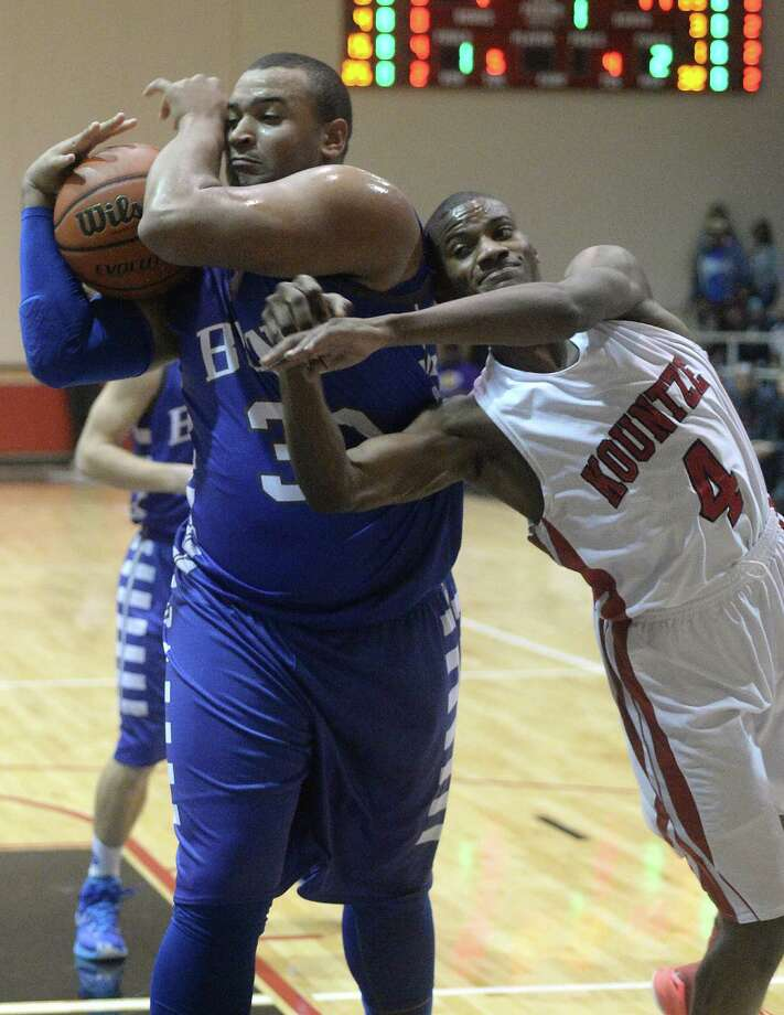 Kountze's Jaydon Cunigan battles with Buna's Tyler Edwards for control of the rebound during Tuesday night's game at Kountze High School. The teams are ranked third and sixth, respectively, in their division.  Photo taken Tuesday, January 13, 2015  Kim Brent/The Enterprise Photo: KIM BRENT / Beaumont Enterprise