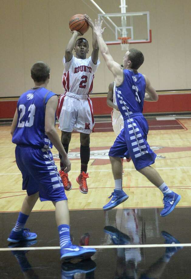 Kountze's Teran Stanford takes his shot as Buna's Joe Clark (#3) moves in to block during Tuesday night's game at Kountze High School. The teams are ranked third and sixth, respectively, in their division. Photo taken Tuesday, January 13, 2015 Kim Brent/The Enterprise Photo: KIM BRENT / Beaumont Enterprise