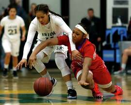 Sacred Heart Cathedral's Gabrielle Vigil (left) and St. Ignatius' Nahrie Pierce vie for a loose ball in 4th quarter of Sacred Heart Cathedral's 60-50 win in girls' Bruce-Mahoney basketball game at War Memorial Gym in San Francisco, Calif. on Tuesday, January 13, 2015.
