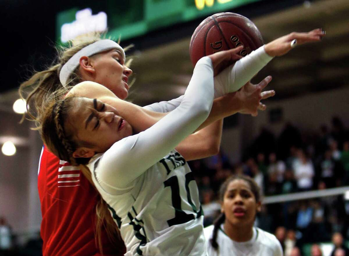 Sacred Heart Cathedral's Kayla Coloyan is fouled by St. Ignatius' Josie Little during 3rd quarter of Sacred Heart Cathedral's 60-50 win in girls' Bruce-Mahoney basketball game at War Memorial Gym in San Francisco, Calif. on Tuesday, January 13, 2015.
