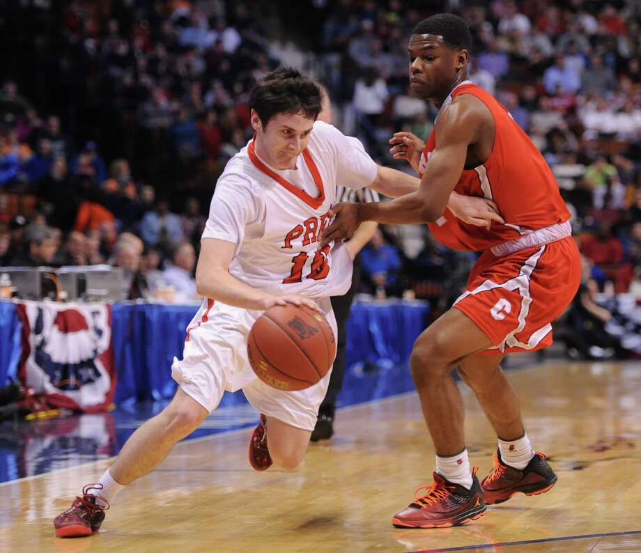 Fairfield Prep point guard Ray Featherston drives past a Central defender during last season's Class LL championship game at the Mohegan Sun Arena. Featherston recently tore his ACL and will miss the rest of the season. Photo: Tyler Sizemore / The News-Times