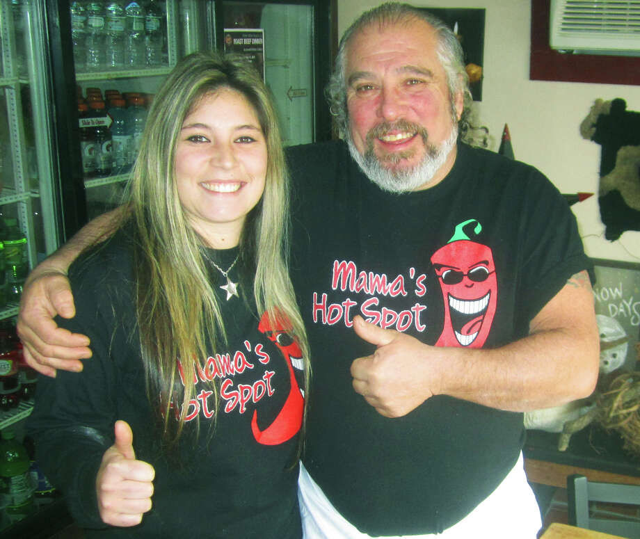 Star Meduri and her father, Dee Meduri, extend a welcoming thumbs up to a first-time patron at Mama's Hot Spot at 358 Danbury Road (Route 7 South) in New Milford. January 2015 Photo: Norm Cummings / The News-Times