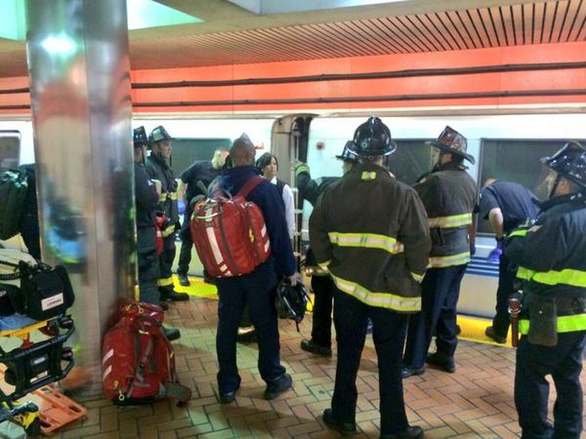 Medics and firefighters at the BART Powell Street Station, where a person fell under a train on the eastbound tracks Wednesday morning.