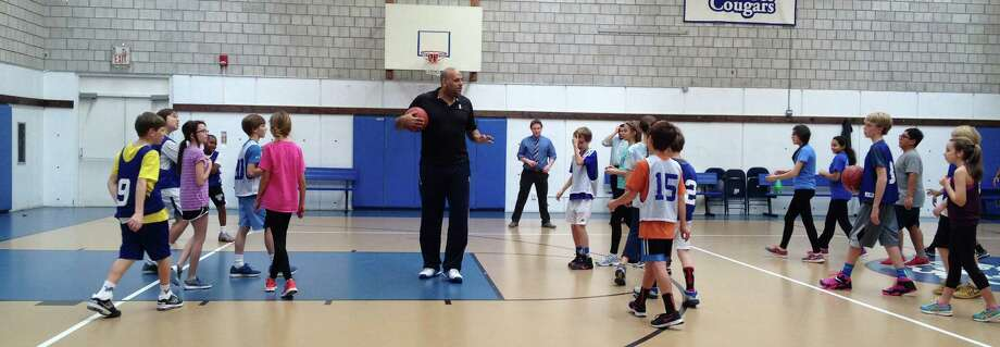 Former NBA plaer John Amaechi works with students at New Canaan Country School on January 8, 2015. Photo: Brooke Springer / New Canaan News