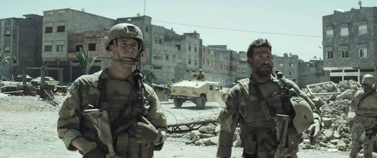 """Jake McDorman, left, and Bradley Cooper in """"American Sniper,"""" which was shy of a Super Bowl Sunday record."""