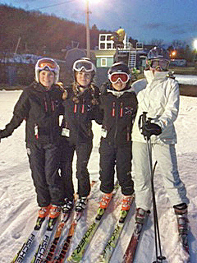 From left to right: NCHS varsity ski team members Megan Waldron, co-captain Amanda Dobbin, co-captain Emily DeTour and Siri Thorbeck take a break during a recent training session at Mount Southington. Photo: Contirbuted, Contributed / New Canaan News