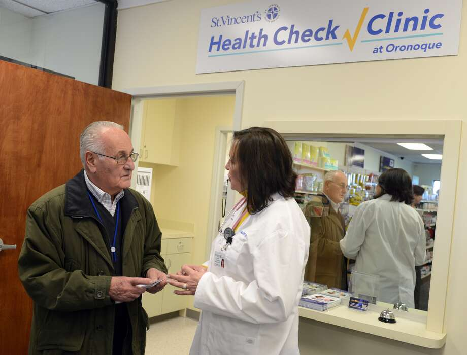 "Dan Libertino talks with Family Nurse Practitioner Lea Alberghini about a shot he needs Tuesday, January 13, 2015 at the St. Vincent's Health Check Clinic at Oronoque, located inside the Oronoque Pharmacy in Stratford, Conn. This is the first retail clinic for St. Vincent's Medical Center and Libertino who lives in Stratford's Oronoque Village expects ""it will be very convenient"" for residents. Photo: Autumn Driscoll, Connecticut Post"