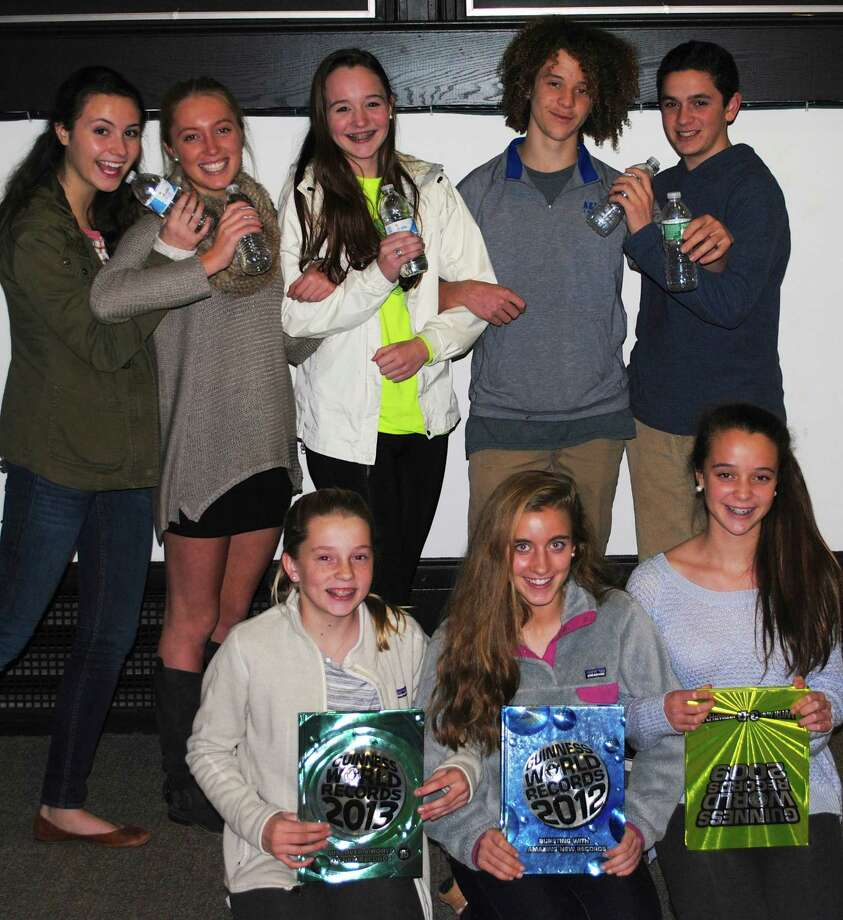 All are invited to help the Darien Youth Commission set a Guinness World RecordsAE for the worldís largest arm-linked toast at Darien Town Hall on January 31 at 2 p.m. Members of the DYC that will participate in the event include, front row: Samantha Ball, Julia OíBrien and Coco Rooney; In the back row are: Sophie Sheldon, Abby Melton, Amanda Barlow, Felix Rooney and Ben Bidell. Participants are asked to bring non-perishable food donations for Person-to-Person. For more information go to www.darienct.gov/yc or call 203-656-7388. Photo: Contributed Photo / Greenwich Time Contributed