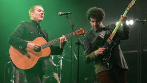 SALISBURY, ENGLAND - SEPTEMBER 01:  Stuart Murdoch and Stevie Jackson of the band Belle & Sebastian perform on stage on Day 3 of End Of The Road Festival 2013 at Larmer Tree Gardens on September 1, 2013 in Salisbury, England.