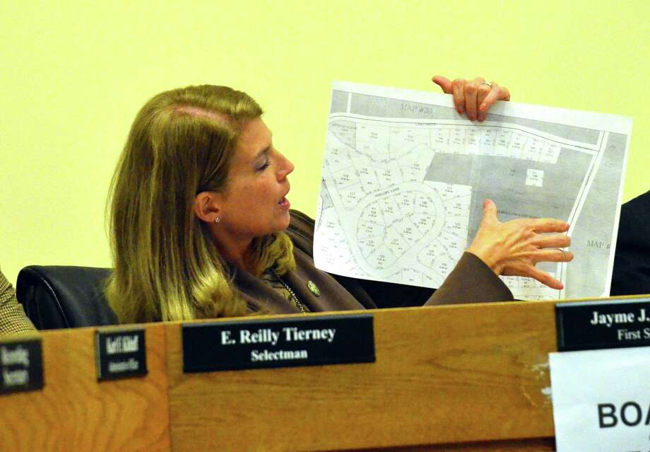 First Selectman Jayme Stevenson says that acquiring properties for the town was one of her major accomplishments during 2014. Here she shows where one of those properties, at 32 Hoyt Street, is in relation to Holmes Elementary School. Photo: Megan Spicer / Darien News