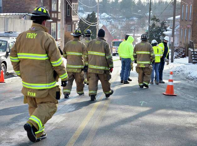 Troy firefighters and National Grid crews investigate the scene of a gas leak at 41 Brunswick Ave. Wednesday, Jan. 14, 2015, in Troy, NY.  (John Carl D'Annibale / Times Union) Photo: John Carl D'Annibale