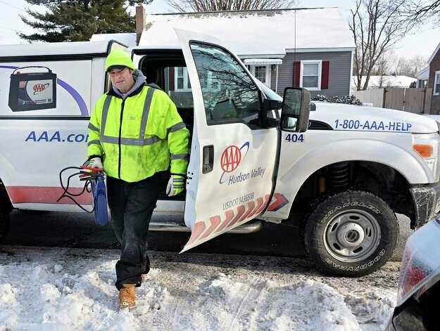 AAA fleet driver Michael Nolan responds to a car won't start call Wednesday Jan. 14, 2015, in Colonie, NY.  (John Carl D'Annibale / Times Union) Photo: John Carl D'Annibale