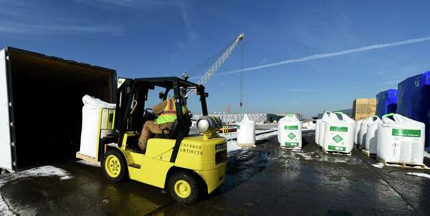 Despite frigid temperatures stevedore Matthew Kelly loads some of the 3000 one ton bags of calcium chloride to be shipped to Canada by truck Wednesday Jan. 14, 2015 at the Port of Albany in Albany, N.Y.     (Skip Dickstein/Times Union) Photo: SKIP DICKSTEIN
