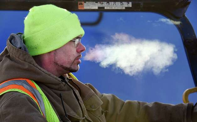 Despite frigid temperatures, stevedore Matthew Kelly concentrates as he loads some of the 3000 one ton bags of calcium chloride to be shipped to Canada by truck Wednesday, Jan. 14, 2015, at the Port of Albany in Albany, N.Y.     (Skip Dickstein/Times Union) Photo: SKIP DICKSTEIN