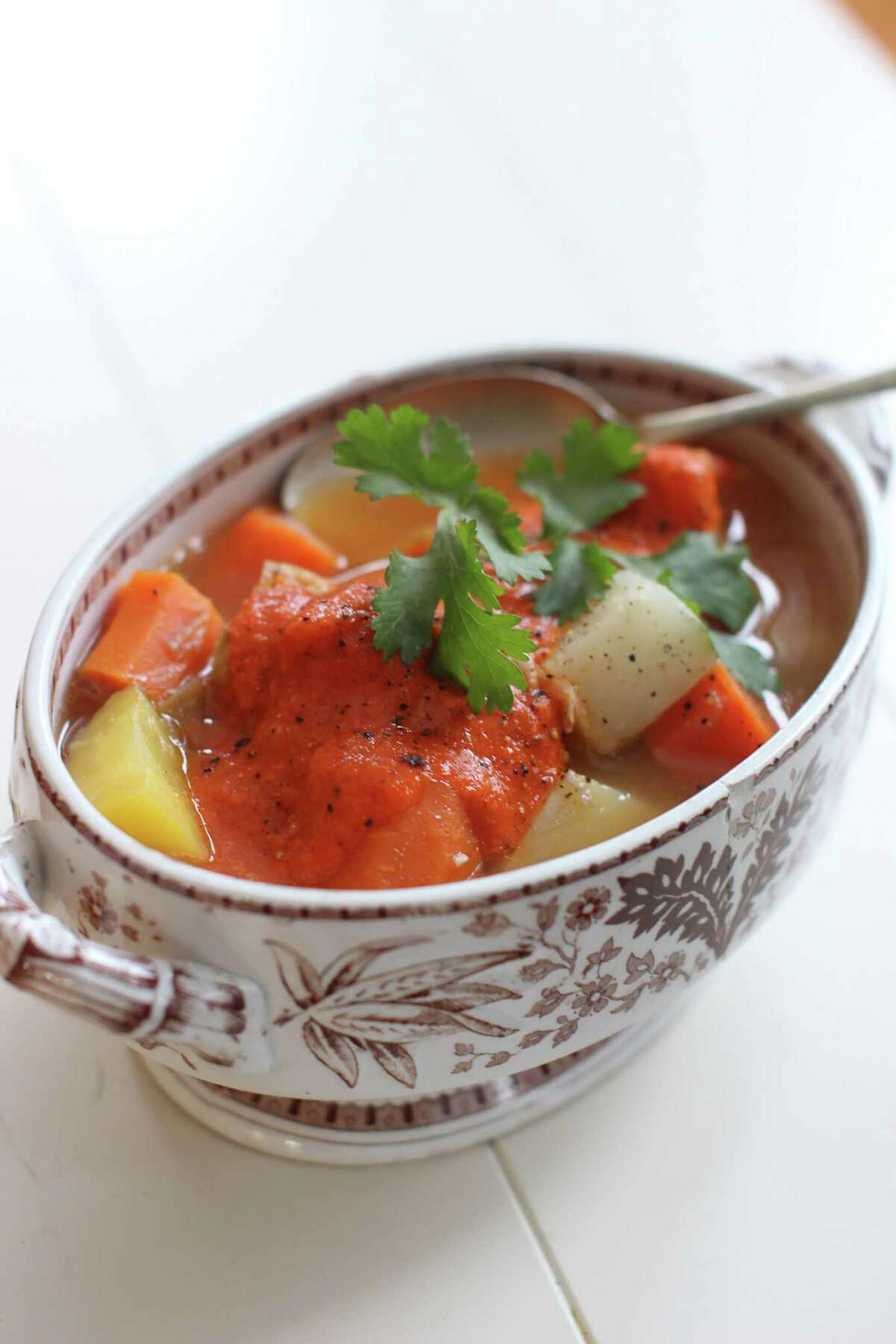 This Dec. 8, 2014 photo shows Moroccan chicken in a pot with harissa in Concord, N.H. (AP Photo/Matthew Mead) ORG XMIT: MER2014122610254002