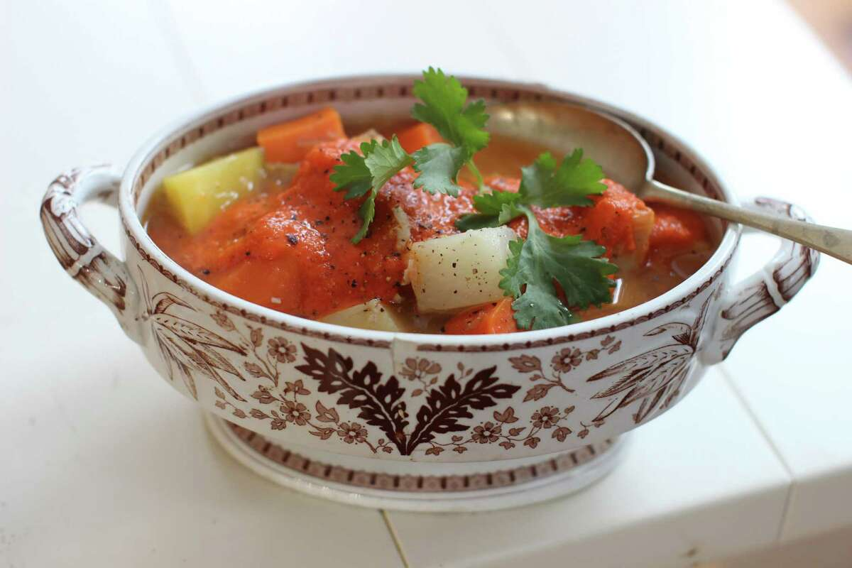 This Dec. 8, 2014 photo shows Moroccan chicken in a pot with harissa in Concord, N.H. (AP Photo/Matthew Mead) ORG XMIT: MER2014122610252501