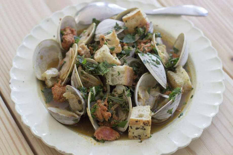 """This Jan. 5, 2015 photo shows spicy clam and kale soup in Concord, N.H. Tucked away between the tofu """"cheeses"""" and textured vegetable protein taco crumbles lies a good go-to and good-for-you ingredient, soy chorizo.  (AP Photo/Matthew Mead) ORG XMIT: MER2015011211543677 Photo: Matthew Mead / FR170582 AP"""