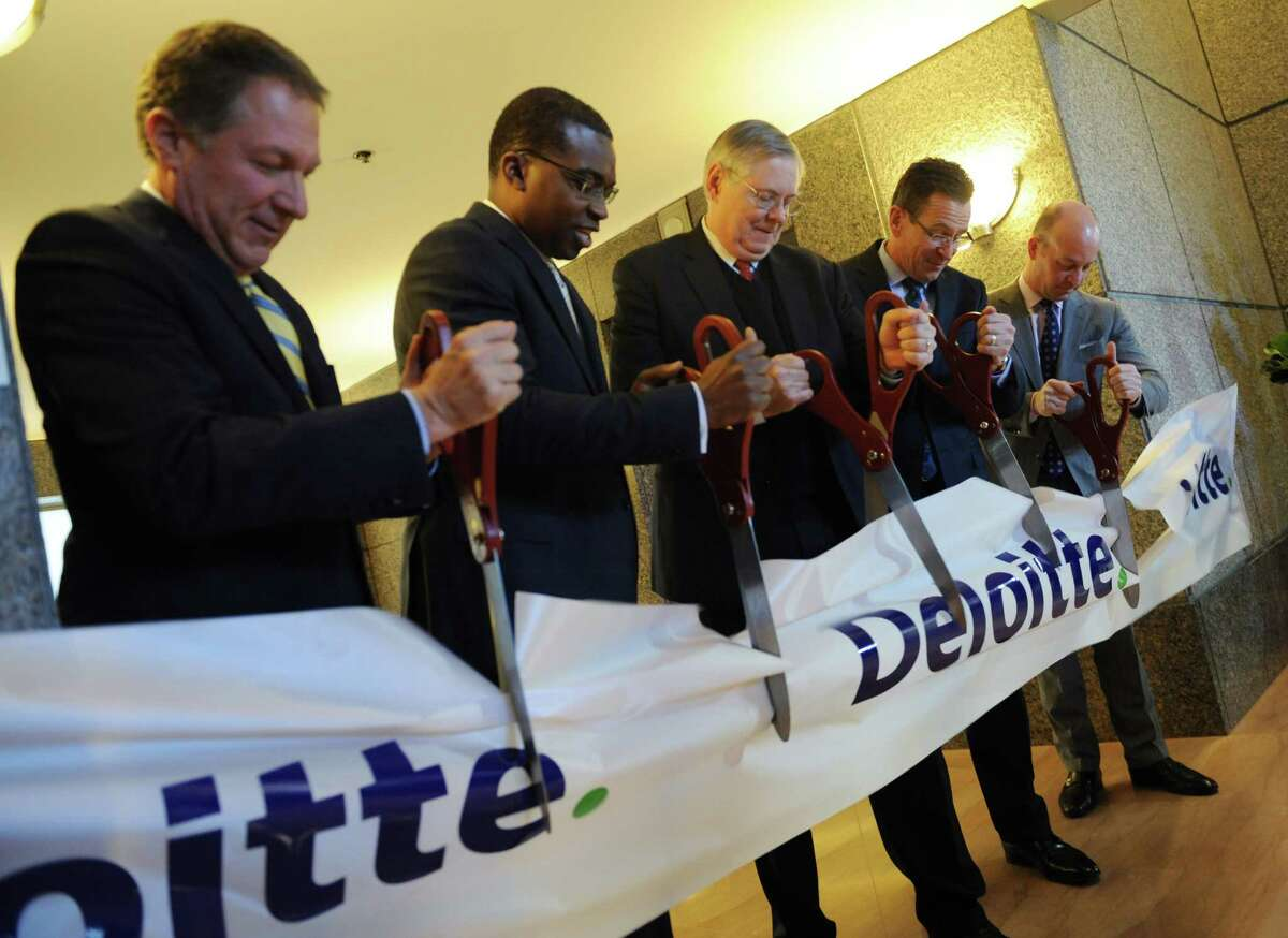 From left, BLT CEO Carl Kuehner, Deloitte Partner Kevin Richards, Stamford Mayor David Martin, Connecticut Gov. Dannel P. Malloy, and Deloitte New York Managing Partner Steve Delucci cut the ribbon for the BLT Financial Centre at 695 E. Main St. in downtown Stamford, Conn. Tuesday, Jan. 13, 2015. Deloitte and BLT held a ribbon-cutting and group tours for the grand opening of the new building recently occupied by Deloitte. Stamford Mayor David Martin and Connecticut Gov. Dannel P. Malloy were on hand for the event.