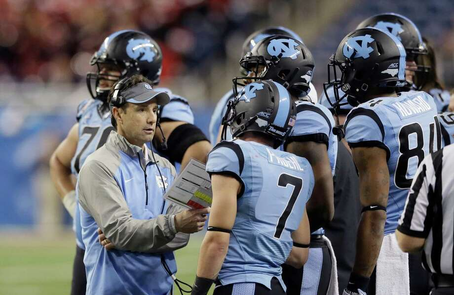 North Carolina head coach Larry Fedora talks to his team during the second half of the Quick Lane Bowl against Rutgers on Dec. 26, 2014, in Detroit. Rutgers defeated North Carolina 40-21. Photo: Carlos Osorio /Associated Press / AP