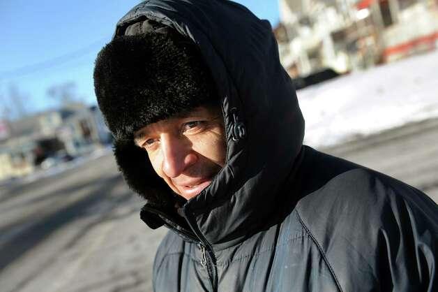 Miguel Martinez bundles up as walks in the cold on Wednesday, Jan. 14, 2015, in Schenectady, N.Y. (Cindy Schultz / Times Union) Photo: Cindy Schultz
