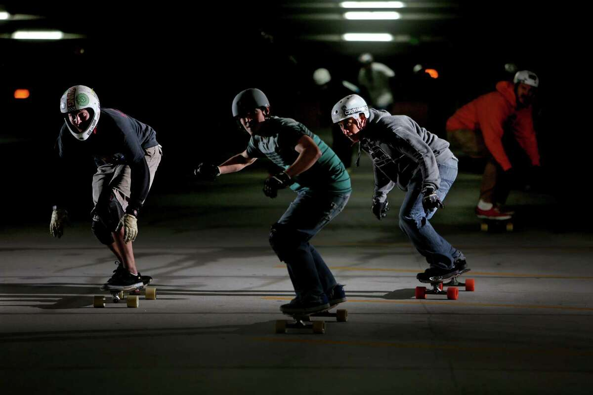 Team No Bull along with other longboard skaters ride in a parking garage Jan. 4, 2015.