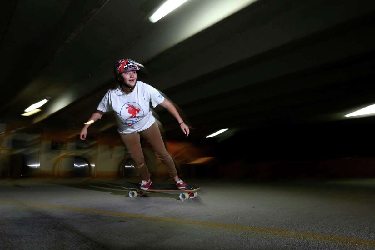 Team No Bull along with other longboard skaters ride in a parking garage Jan. 3, 2015, in Houston.