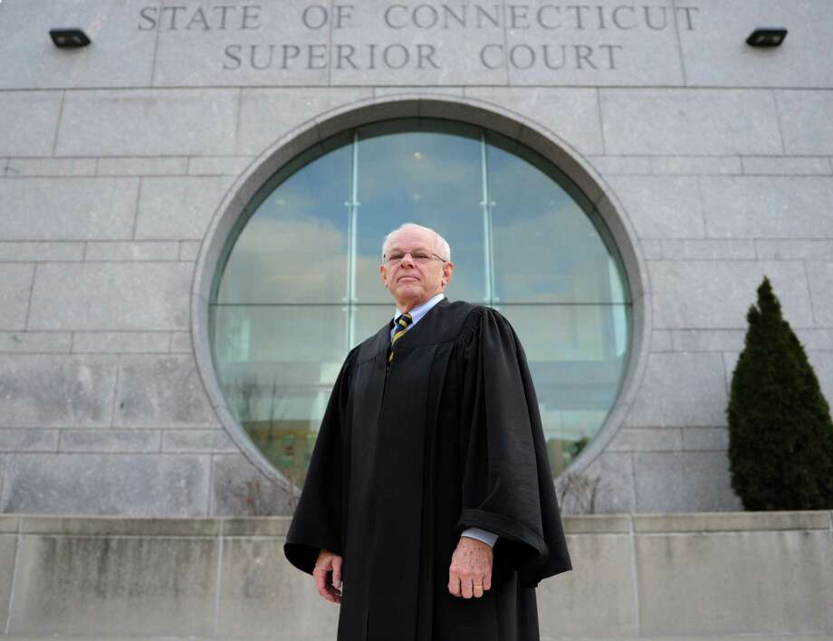 The Hon. Richard Comerford poses outside the State of Connecticut Superior Court in Stamford, Conn. Wednesday, Jan. 14, 2015.  Judge Comerford, who has been on the bench in Stamford for many years, has turned 70 and will soon become a judge trial referee. Photo: Tyler Sizemore / Greenwich Time