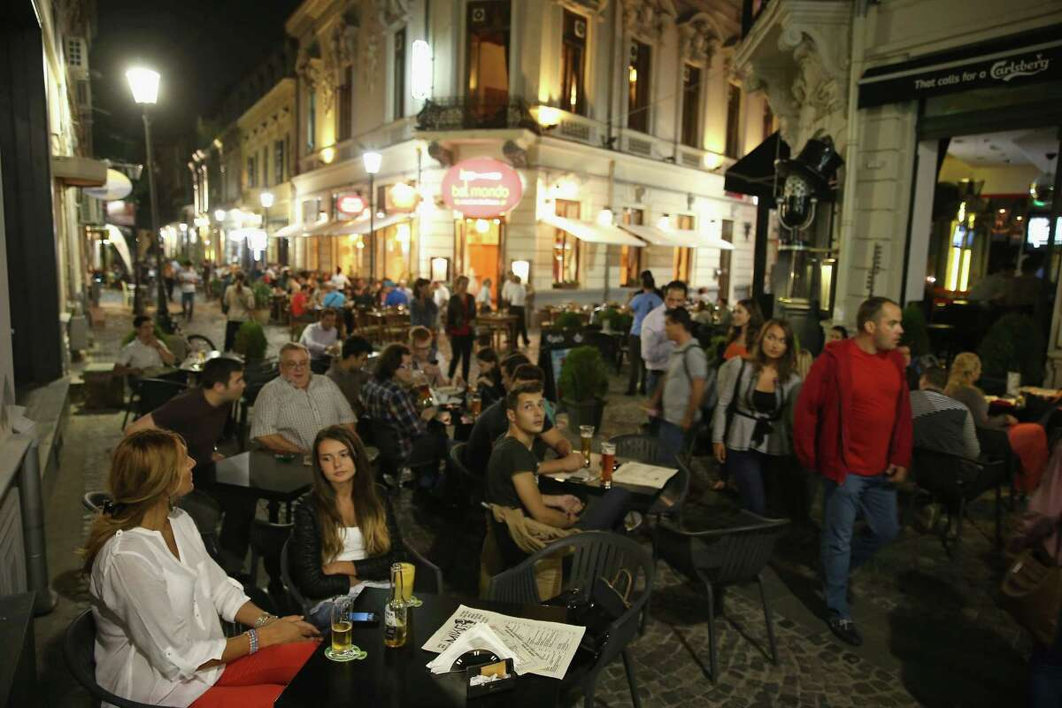 BEST OVERALL CHEAP CAPITAL (RUNNER-UP) : Bucharest. Bucharest remains more of a launchpad for exploring the rest of Romania than a tourist destination in its own right. (Above: Visitors enjoy dinner and drinks al fresco in the Old Town Lipscani district.)