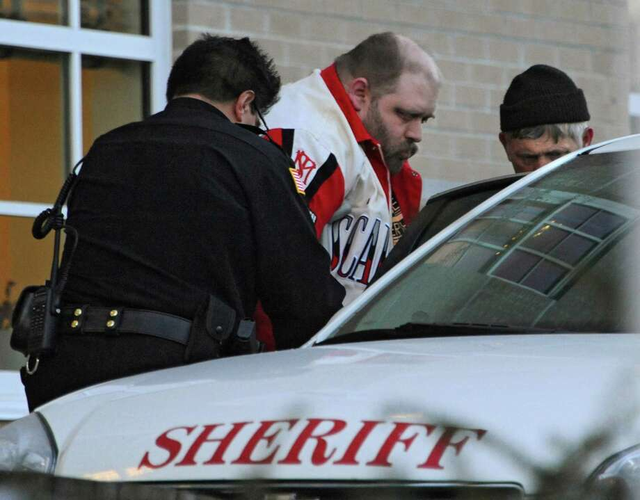 Steven D. Walker, who pleaded guilty to pulling out the teeth of a disabled girl in his care, leaves Schoharie County Court after being sentenced to four years in prison on Wednesday, Jan. 14, 2015 in Schoharie, N.Y.  (Lori Van Buren / Times Union) Photo: Lori Van Buren / 00030204A