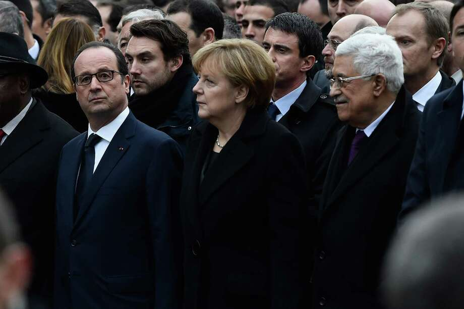 Arguably, President Obama's presence at the Paris demonstration would have made security even more problematic. Francois Hollande, Angela Merkel and Mahmoud Abbas walk during a mass unity rally following the recent terrorist attacks on January 11, 2015 in Paris, France. Photo: Pascal Le Segretain /Getty Images / 2015 Getty Images