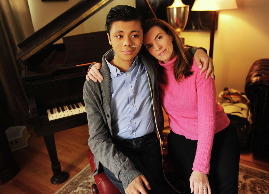 Mitchell Yeoh, 18, with his mom Lezah Yeoh in their home in Fairfield, Conn. on Wednesday, January 14, 2015. Mitchell, who suffers from a rare genetic disorder, is on leave from his freshman year at Harvard as he waits for both liver and kidney transplants. Photo: Brian A. Pounds / Connecticut Post