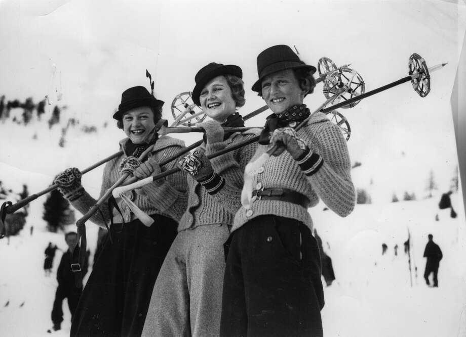 Three visitors to St. Moritz, the popular Swiss Winter sports resort, wearing Tyrolean hats in Switzerland around 1935. Photo: Imagno, Getty Images