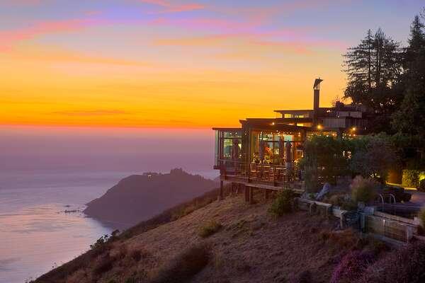 The sun sets on the Post Ranch Inn's Sierra Mar restaurant.