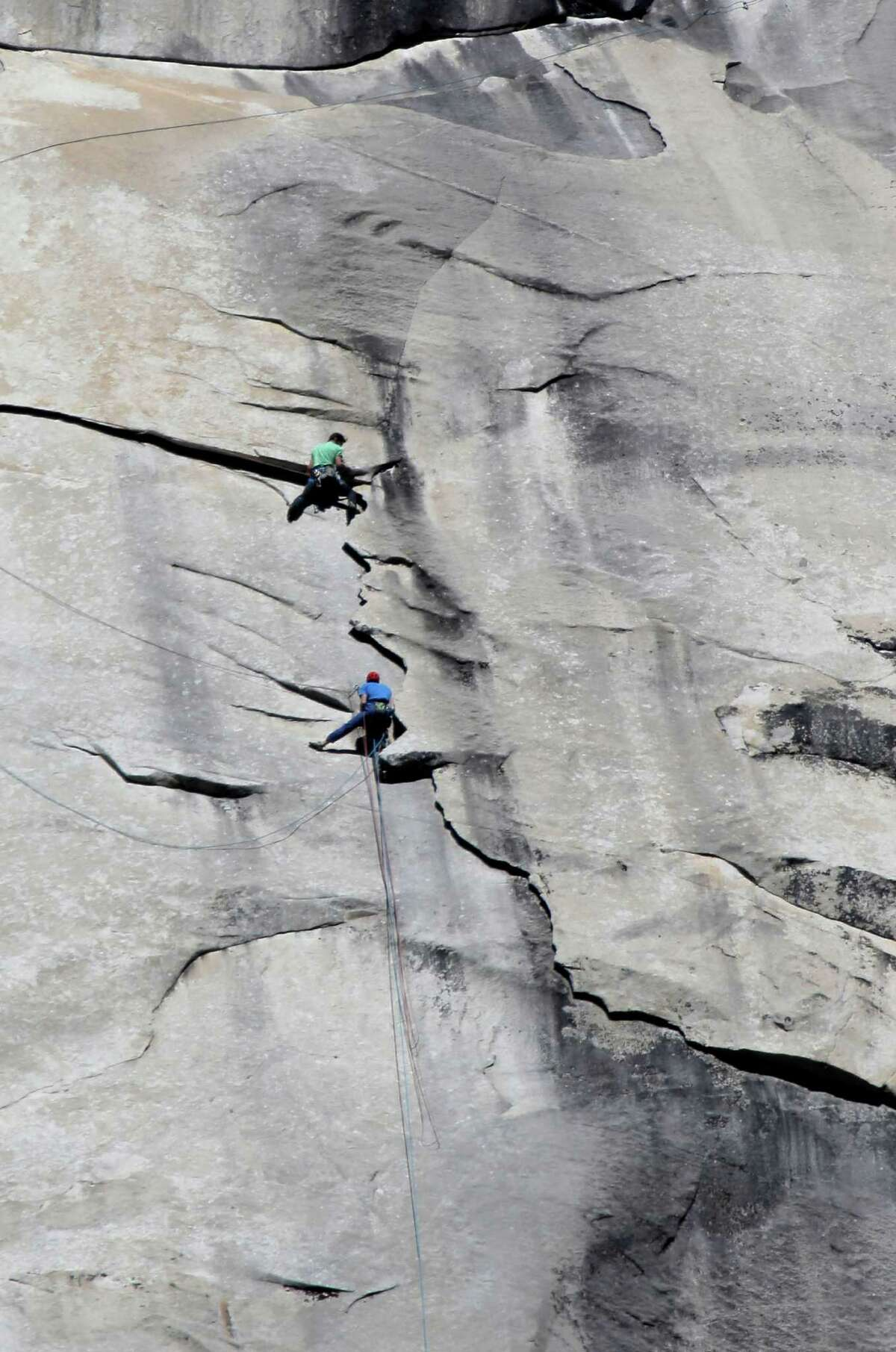 Tommy Caldwell (bottom) and Kevin Jorgeson reach pitch 29 on the face of El Capitan during their record-setting free climb in in Yosemite National Park.